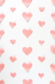 淡いピンクのハートが並んだ背景素材 2 縦位置