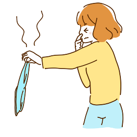 臭いのする洗濯物を汚そうに持つ若い女性のイラスト
