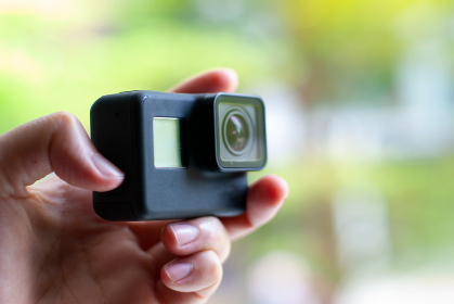 Action camera, equipment for extreme sports On a green backgroun
