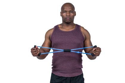 Fit man exercising with resistance band