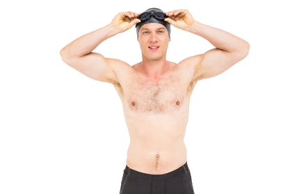 Portrait of swimmer holding swimming goggles