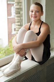 Ballerina sitting on windowsill