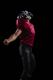American football player posing with arms stretched open
