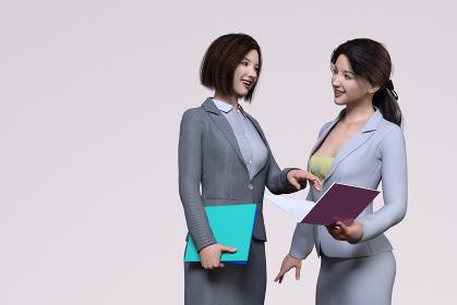 スーツを着た女性社員が2人で資料に目を通しながら確認している