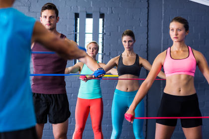 Athletes looking at trainer while exercising