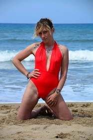 Rebel blonde girl poses in swimsuit