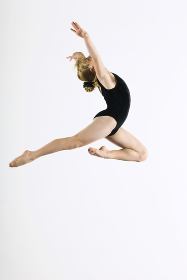 Gymnast Leaping In Air