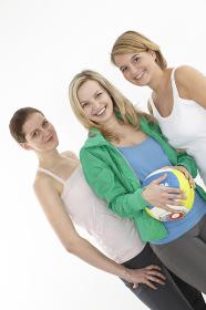 three women with beachvolleyball