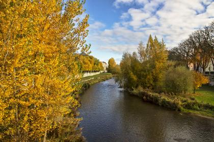 Arlanzón River as it passes through Burgos during autumn