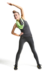 athletic training slender woman in a black dress aerobic sports\rathletic slender woman practicing aerobics in a black sports outfit.