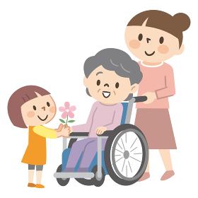 車椅子のシニア女性と家族