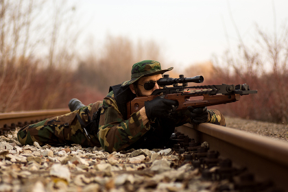 military man aiming with crossbow