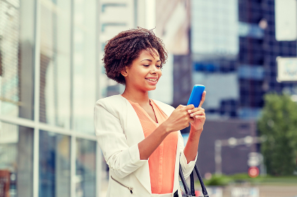 happy african businesswoman with smartphone