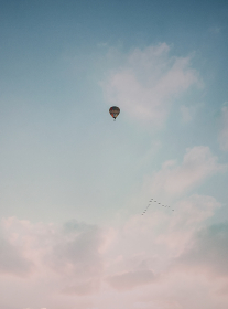 hot air balloon flying between clouds , Tunuyán, Mendoza Province, Argentina