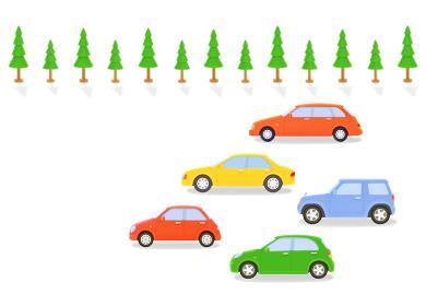 カラフルな5台の車と街路樹