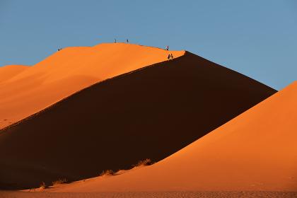 peoples on dune in Hidden Vlei, Namibia, Africa