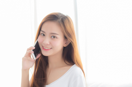 Beautiful of portrait young asian woman talking smart mobile pho
