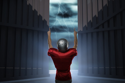 Composite image of rear view of american football player with arms raised 3d