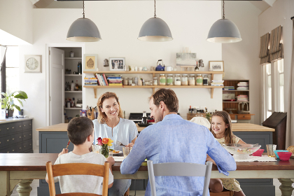 White family of four having lunch in their kitchen at home