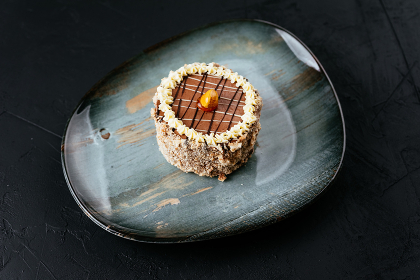 fruit and chocolate desserts on a textured black background