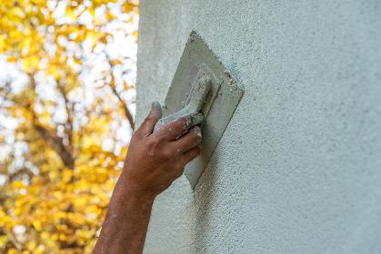 Application Of Facade Plaster in autumn.