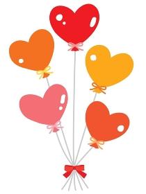 赤やピンクやオレンジのカラフルな5つのハート形の風船