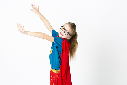 blond supergirl with glasses and red robe und blue shirt is posing in the studio