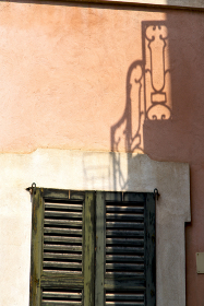 shutter europe  italy  lombardy        in  the milano old   window closed brick      abstract grate