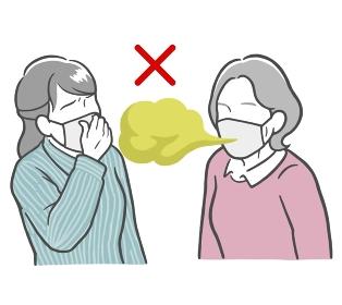 マスクをした口臭がきつい中年女性と鼻をつまむ若い女性