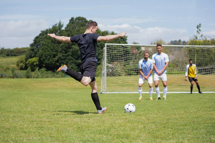 Football player taking a penalty shot