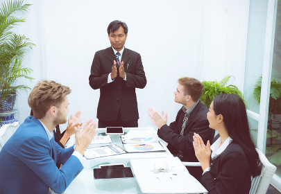 business people clapping around of coworker conference in meetin