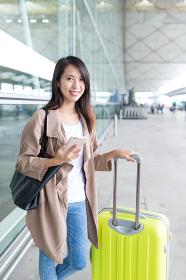 Asian woman go travel at Hong Kong international airport