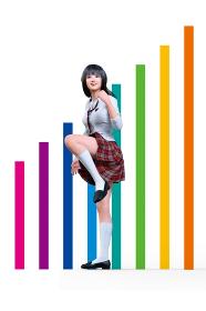 七色の階段状になった棒グラフのオブジェの前で自分の将来の目標に向かって挑戦的なファイティングポーズ