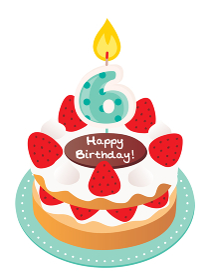 6歳のキャンドルをのせた苺と生クリームのお誕生日ケーキ