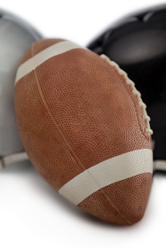 Close up of American football by sports helmet