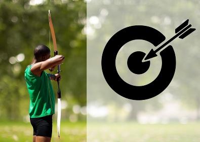 Male athlete practicing archery