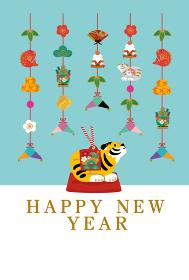 寅年 年賀状デザイン 2022年 トラの置物のイラスト つるし飾り
