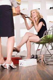 Young woman in a shoe shop