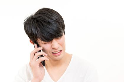 男性・電話・スマートフォン(感情)