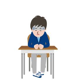 席に座りうつむいている顔色の悪い男子学生