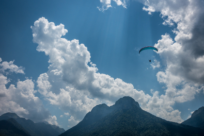 Paraglider Flies Over French Alps and Clouds in Annecy France