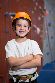 Boy standing with arms crossed in fitness studio