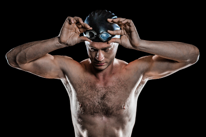 Swimmer holding swimming goggles