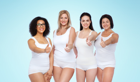 group of happy different women showing thumbs up