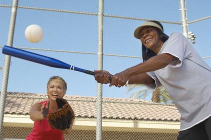 Female Friends Playing Baseball