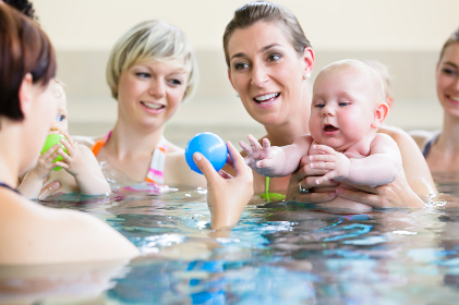 Babies and their moms at mother-and-child-swimming class