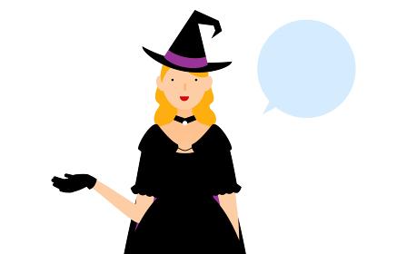 ハロウィンの仮装、魔女姿の女性が右手を出して話しているポーズ(吹き出しつき)
