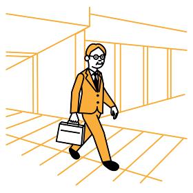 ビジネスシーン オフィス街を歩く男性