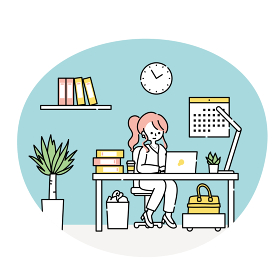 オフィスでパソコンに向かって仕事をする女性