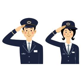 敬礼する鉄道員の男女